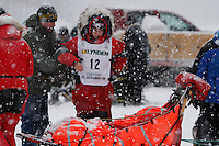 Meredith Mapes puts her bib on just prior to the start of the 2009 Junior Iditarod on Knik Lake on Saturday Februrary 28, 2009.
