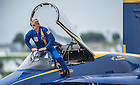 U.S. Navy Lieutenant Commander John Hlitz '02 gets out of his jet after a demonstration flight with the Blue Angels Flight Demonstration Squadron. <br /> <br /> Photo by Matt Cashore/University of Notre Dame