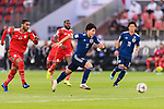 Minamino Takumi of Japan (C) runs with the ball during the AFC Asian Cup UAE 2019 Group F match between Oman (OMA) and Japan (JPN) at Zayed Sports City Stadium on 13 January 2019 in Abu Dhabi, United Arab Emirates. Photo by Marcio Rodrigo Machado / Power Sport Images