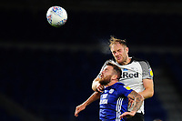 Joe Ralls of Cardiff City vies for possession with Matthew Clarke of Derby County during the Sky Bet Championship match between Cardiff City and Derby County at the Cardiff City Stadium in Swansea, Wales, UK. Tuesday 14 July 2020
