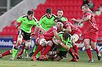 Scarlets lock Lewis Rawlins hauls down Munster prop Stephen Archer.<br /> Guiness Pro12<br /> Scarlets v Munster<br /> 21.02.15<br /> ©Steve Pope -SPORTINGWALES