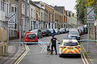 Pictured: A Police Canine Unit at the area where a 22 year old woman was attacked in Carlton Terrace, Swansea, Wales, UK. Tuesday 23 April 2019<br /> Re: A 22 year old woman, named locally as Sammy Lee Lodwig, has died after being attacked Carlton Terrace in Swansea at 3:10am.<br /> South Wales Police said a woman had been seriously assaulted and subsequently died.<br /> Armed officers were deployed, along with the police helicopter, and a number of cordons remain in place while officers carry out an investigation.