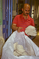 Tunisian Hat, Chechia.  Newly-Knitted Hats Being Bagged to Take for Boiling and Dyeing.