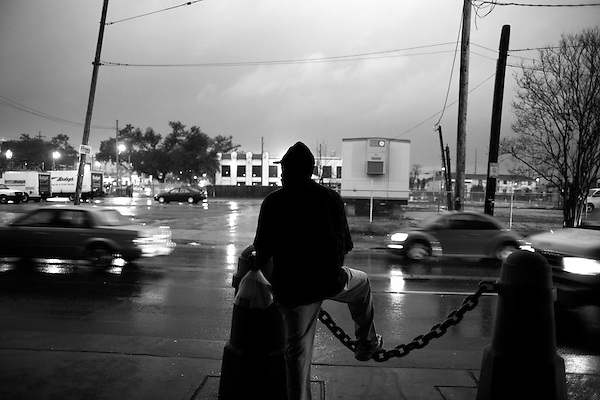 January 31, 2008. New Orleans, LA.. A homeless man watches traffic during a rally for the homeless under the I-10 freeway. The homeless population of New Orleans has exploded since Hurricane Katrina leveled the city and little housing has been rebuilt.