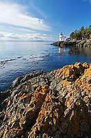 Lime Kiln Lighthouse and rocky shoreline, Lime Kiln Point State Park, San Juan Island, Washington