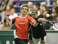 25-2-06, Netherlands, tennis, Rotterdam, ABNAMROWTT,  Jarkko Nieminen in action against Christophe Rochus