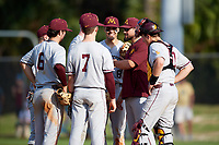 Minnesota Golden Gophers pitching coach Ty McDevitt talks with pitcher ? as Luke Pettersen (13), Terrin Vavra (6), Jordan Kozicky (7), Micah Coffey (8), and Cole McDevitt (10) listen in during a game against the Boston College Eagles on February 23, 2018 at North Charlotte Regional Park in Port Charlotte, Florida.  Minnesota defeated Boston College 14-1.  (Mike Janes/Four Seam Images)