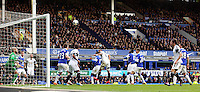 Pictured: Ashley Williams of Swansea (C) scores a goal with a header during the last minutes of the game, making the final score 3-2. Saturday 22 March 2014<br /> Re: Barclay's Premier League, Everton v Swansea City FC at Goodison Park, Liverpool, UK.