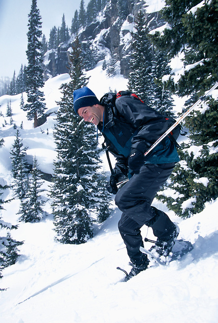 Man having fun while snowshoeing downhill, Rocky Mtn Nat'l Park, CO