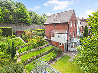 BNPS.co.uk (01202 558833)<br /> Pic: Homesestateagency/BNPS<br /> <br /> Pictured: The garden with its stepped flower beds.<br /> <br /> A timewarp home that has been lived in by the same family for more than a century has gone on sale for the first time since being built.<br /> <br /> At the time the property was built, King Edward VII was on the throne and the First World War had not even started.<br /> <br /> The property is being sold for £550,000 under probate by the original builder's three grandchildren, who were born in the Victorian-style house.<br /> <br /> The two-bedroomed home is in the Surrey town of Haslemere and belonged to the Berry family, who decided to sell after the death of their parents, Freda and Leslie.