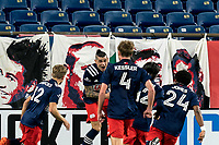 FOXBOROUGH, MA - NOVEMBER 20: Gustavo Bou #7 of New England Revolution celebrates his goal with teammates during the Audi 2020 MLS Cup Playoffs, Eastern Conference Play-In Round game between Montreal Impact and New England Revolution at Gillette Stadium on November 20, 2020 in Foxborough, Massachusetts.