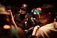 Washington, DC - June 1, 2020: Sgt. J. Tubbs, of the D.C. Metropolitan Police Department, engages in a conversation with a group of individuals as protesters gather at 15th & Swann St. NW, Washington, DC  June 1, 2020, in the wake of the death of George Floyd by a Minnesota police officer.  (Photo by Don Baxter/Media Images International)