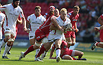Guiness Pro12<br /> Scarlets flanker Rob McCusker charges in to tackle Ulster center Stuart Olding<br /> Scarlets v Ulster<br /> Parc y Scarlets<br /> <br /> 06.09.14<br /> ©Steve Pope-SPORTINGWALES