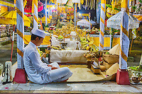 Bali, Indonesia.  Young Hindu Priest in Contemplation.  Pura Dalem Temple, Dlod Blungbang Village.