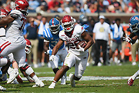 Arkansas running back Dominique Johnson (20) carries the ball, Saturday, October 9, 2021 during the third quarter of a football game at Vaught Hemingway Stadium in Oxford, Miss. Check out nwaonline.com/211010Daily/ for today's photo gallery. <br /> (NWA Democrat-Gazette/Charlie Kaijo)