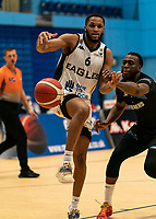 Martelle McLemore of Surrey Scorchers fouls Cortez Edwards of Newcastle Eagles during the BBL Championship match between Surrey Scorchers and Newcastle Eagles at Surrey Sports Park, Guildford, England on 20 March 2021. Photo by Liam McAvoy.