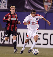 The Fire's Ivan Guerrero is chased by Chris Leitch of the MetroStars. The Chicago Fire defeated the MetroStars 1 - 0 at Giant's Stadium, East Rutherford, NJ, on Friday April 22, 2005.