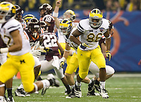 Kevin Koger of Michigan in action during Sugar Bowl game against Virginia Tech at Mercedes-Benz SuperDome in New Orleans, Louisiana on January 3rd, 2012.  Michigan defeated Virginia Tech, 23-20 in first overtime.