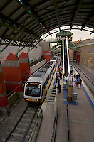 A state of the art electrically powered light rail vehicle makes a stop at the Mockingbird Lane Station. Mass transit. Dallas Texas USA.