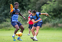 Luke O'Nien knocks the ball past Anthony Stewart during the Wycombe Wanderers 2016/17 Pre Season Training Session at Wycombe Training Ground, High Wycombe, England on 1 July 2016. Photo by Andy Rowland / PRiME Media Images.