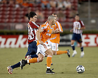 Houston Dynamo defender Wade Barrett (24) attempts to protect the ball from CD Chivas USA midfielder Sacha Kljestan (16).  Houston Dynamo defeated CD Chivas USA 4-0 at Robertson Stadium in Houston, TX on June 21, 2007.