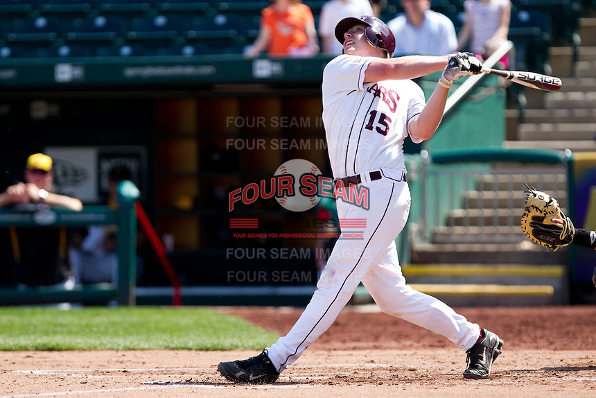 Tyler Paxson (15) of the Missouri State Bears hits a pop fly during a game against the Wichita State Shockers on April 9, 2011 at Hammons Field in Springfield, Missouri.  Photo By David Welker/Four Seam Images