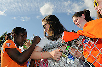 Anita Asante (5) of Sky Blue FC signs autographs for fans after the game. Sky Blue FC defeated the Boston Breakers 1-0 during a Women's Professional Soccer match at Yurcak Field in Piscataway, NJ, on July 4, 2009.