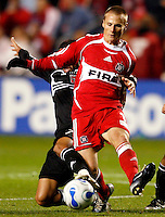 DC United midfielder Fred (7) attempts to knock the ball away from Chicago Fire forward Chris Rolfe (17). The Chicago Fire defeated D. C. United 1-0 during the first leg of the MLS Eastern Conference Semifinal Series at Toyota Park in Bridgeview, IL, on October 25, 2007.
