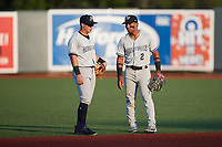 (L-R) Hudson Valley Renegades shortstop Anthony Volpe (5) chats with second baseman Ezequiel Duran (2) during the game against the Aberdeen IronBirds at Leidos Field at Ripken Stadium on July 23, 2021, in Aberdeen, MD. (Brian Westerholt/Four Seam Images)
