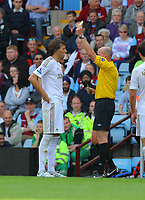 Saturday 15 September 2012<br /> Pictured L-R: Michu of Swansea is shown a yellow card by match referee L Mason. <br /> Re: Barclay's Premier League, Aston Villa v Swansea City FC at Villa Park, West Midlands, UK.