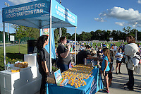 Kansas City, MO - Saturday May 28, 2016: Fans stop at the Mango booth at the game between FC Kansas City and Orlando Pride during a regular season National Women's Soccer League (NWSL) match at Swope Soccer Village. Kansas City won 2-0.