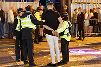 Pictured: A man is placed under arrest by police officers. Friday 14 December 2018<br /> Re: Revellers in Wind Street, Swansea, Wales, UK.