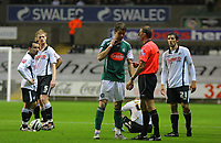 ATTENTION SPORTS PICTURE DESK<br /> Pictured: (L-R) Leon Britton, Alan Tate, David Cotterill and Federico Bessone of Swansea City in action <br /> Re: Coca Cola Championship, Swansea City Football Club v Plymouth Argyle at the Liberty Stadium, Swansea, south Wales. Tuesday 08 December 2009