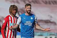 Peterborough United's Mark Beevers and Sunderland's Dion Sanderson during Peterborough United vs Sunderland AFC, Sky Bet EFL League 1 Football at London Road on 5th April 2021