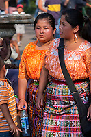 Antigua, Guatemala.  Two Young Maya Women Walking.  Semana Santa.