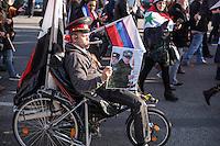"""250 bis 300 Menschen demonstrierten am Samstag den 31. Oktober 2015 in Berlin fuer die Unterstuetzung des syrischen Diktators Assad durch Russland. Sie trugen Fahnen Syriens, der ehemaligen Sowietunion, Russlands, Nordkoreas, der DDR, des Iran und Venezuelas, die sich """"alle zusammen gegen den Imperialismus zur Wehr setzen"""" wuerden. Russlands Praesident Putin wurde ausdruecklich fuer sein Militaerengagement gedankt, das Eingreifen der USA verurteilt.<br /> Im Bild: Ein Demonstrant hat sich mit einer russischen Militaeruniform verkleidet.<br /> 31.10.2015, Berlin<br /> Copyright: Christian-Ditsch.de<br /> [Inhaltsveraendernde Manipulation des Fotos nur nach ausdruecklicher Genehmigung des Fotografen. Vereinbarungen ueber Abtretung von Persoenlichkeitsrechten/Model Release der abgebildeten Person/Personen liegen nicht vor. NO MODEL RELEASE! Nur fuer Redaktionelle Zwecke. Don't publish without copyright Christian-Ditsch.de, Veroeffentlichung nur mit Fotografennennung, sowie gegen Honorar, MwSt. und Beleg. Konto: I N G - D i B a, IBAN DE58500105175400192269, BIC INGDDEFFXXX, Kontakt: post@christian-ditsch.de<br /> Bei der Bearbeitung der Dateiinformationen darf die Urheberkennzeichnung in den EXIF- und  IPTC-Daten nicht entfernt werden, diese sind in digitalen Medien nach §95c UrhG rechtlich geschuetzt. Der Urhebervermerk wird gemaess §13 UrhG verlangt.]"""
