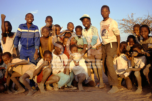 Dodoma, Tanzania. Group of children, one holding a home-made ball.