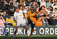 Jamal Campbell-Ryce of Barnet battles Oli McBurnie of Swansea City during the 2017/18 Pre Season Friendly match between Barnet and Swansea City at The Hive, London, England on 12 July 2017. Photo by Andy Rowland.