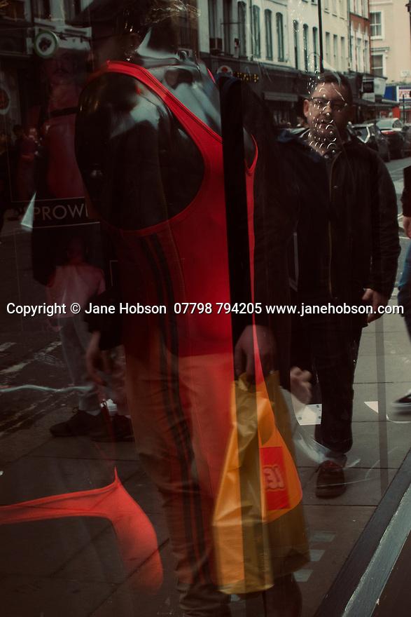 London, UK. 02.02.2020. Reflections in a shop window, Soho, London, UK. Photograph © Jane Hobson.