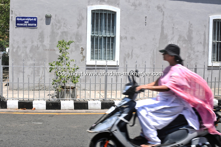 A lady on a scooter at the French colony in Pondicherry. Arindam Mukherjee