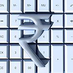 Indian Rupee symbol over calculator representing auditing