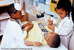 Preschool 4-5 year olds pretend play girl and boy in medical outfits tending to boy patient horizontal