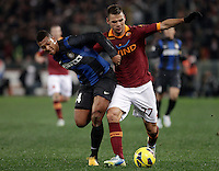 Calcio, semifinale di andata di Coppa Italia: Roma vs Inter. Roma, stadio Olimpico, 23 gennaio 2013..AS Roma midfielder Panagiotis Tachtsidis, of Greece, right, is challenged by FC Inter midfielder Fredy Guarin, of Colombia, during the Italy Cup football semifinal first half match between AS Roma and FC Inter at Rome's Olympic stadium, 23 January 2013..UPDATE IMAGES PRESS/Riccardo De Luca