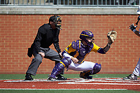 East Carolina Pirates catcher Ben Newton (24) sets a target as home plate umpire Richie Hogg looks on during the game against the Charlotte 49ers at Hayes Stadium on March 8, 2020 in Charlotte, North Carolina. The Pirates defeated the 49ers 4-1. (Brian Westerholt/Four Seam Images)