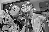 Bosnian Serb leader Radovan Karadzic (right) listens to his top commander, general Ratko Mladic outside their Pale headquarters on Thursday, August 5, 1993.