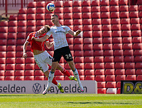 24th April 2021, Oakwell Stadium, Barnsley, Yorkshire, England; English Football League Championship Football, Barnsley FC versus Rotherham United; Michael Smith of Rotherham and Mads Juel Andersen of Barnsley challenge for a header