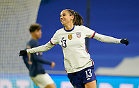 LE HAVRE, FRANCE - APRIL 13: Alex Morgan #13 of the United States scores a goal and celebrates during a game between France and USWNT at Stade Oceane on April 13, 2021 in Le Havre, France.