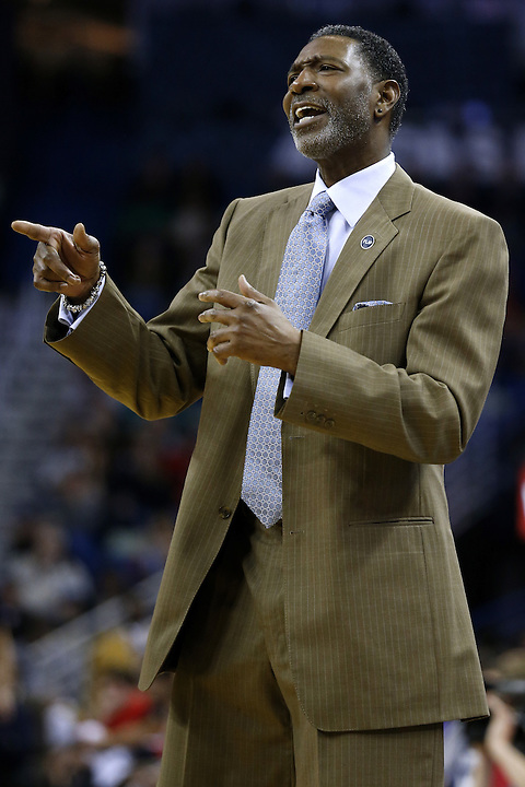 Minnesota Timberwolves head coach Sam Mitchell reacts during the first half of an NBA basketball game Tuesday, Jan. 19, 2016, in New Orleans. (AP Photo/Jonathan Bachman)