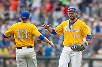 UC Santa Barbara Gauchos first baseman Austin Bush (44) celebrates with teammate Ryan Clark (13) after defeating the Miami Hurricanes in Game 5 of the NCAA College World Series on June 20, 2016 at TD Ameritrade Park in Omaha, Nebraska. UC Santa Barbara beat Miami  5-3. (Andrew Woolley/Four Seam Images)