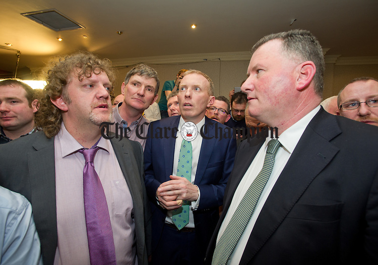 Timmy Dooley listens to the announcement of his election with councillors Alan O Callaghan and Pat Hayes at the count in Ennistymon. Photograph by John Kelly.